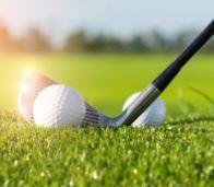 golf ball on driver club