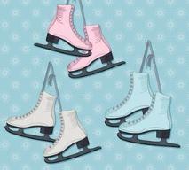 three paid of ice skates hanging